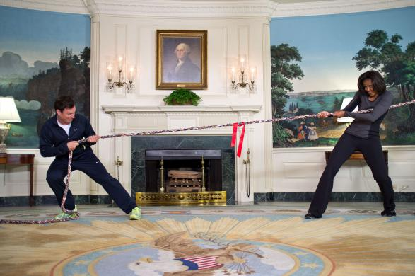 Handout image of Michelle Obama with Jimmy Fallon in a tug of war