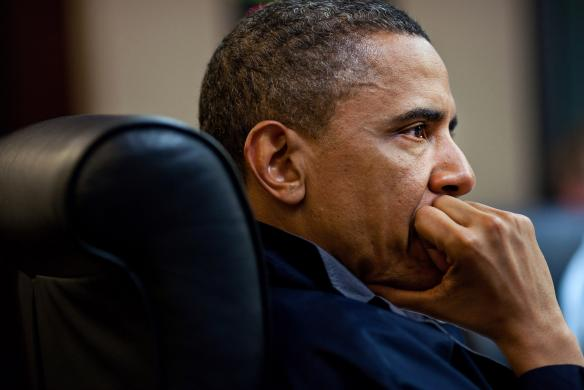 U.S. President Barack Obama listens during a meeting discussing the mission against Osama bin Laden, in the Situation Room of the White House